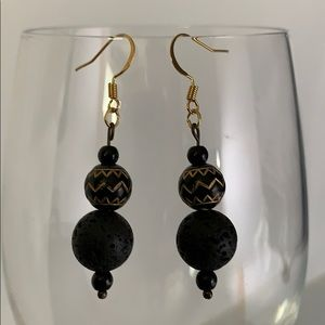 Black round volcanic stone earrings